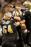 NEW ORLEANS, LA - DECEMBER 26:   Quarterback Drew Brees #9 of the New Orleans Saints celebrates with teammates after Brees throws a nine-yard touchdown pass to running back Darren Sproles #43 and breaks the single-season passing record in the fourth quarter against the Atlanta Falcons at Mercedes-Benz Superdome on December 26, 2011 in New Orleans, Louisiana.  The Saints defeated the Falcons 45-16.  (Photo by Wesley Hitt/Getty Images) *** Local Caption *** Drew Brees