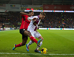 CARDIFF, WALES - Tuesday, February 11, 2014: Cardiff City's Kevin Theophile-Catherine in action against Aston Villa's Joe Bennett during the Premiership match at the Cardiff City Stadium. (Pic by David Rawcliffe/Propaganda)