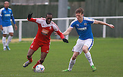 Whitehawk midfielder Arnaud Mendy takes on Dover defender Sean Raggett during the FA Trophy match between Whitehawk FC and Dover Athletic at the Enclosed Ground, Whitehawk, United Kingdom on 12 December 2015. Photo by Bennett Dean.