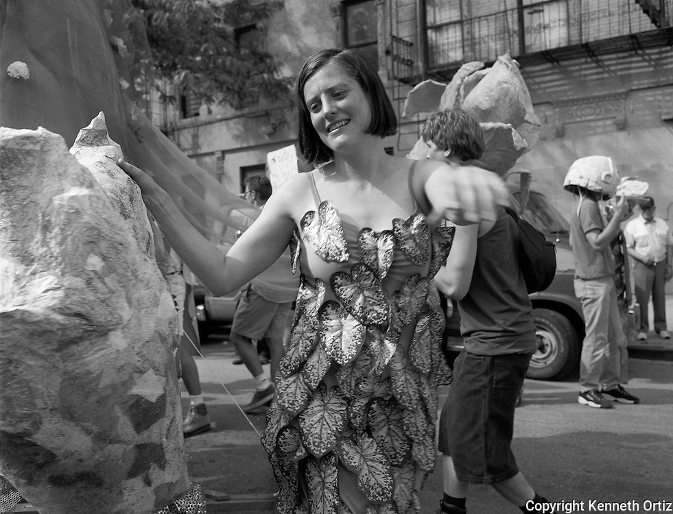 A young woman in dancing in a parade on the Lower East Side.