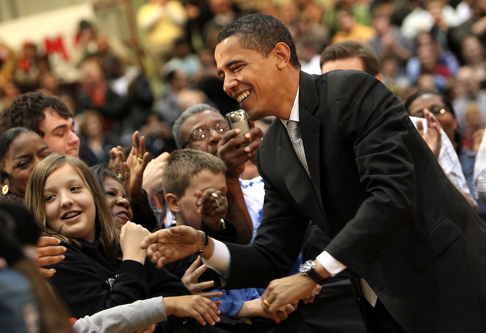 Chris Bergin / The Star Press..Barack Obama shakes hands with supporters before his speech at Irving Gymnasium at Ball State Saturday morning. Following his speech he answered questions from the audience.