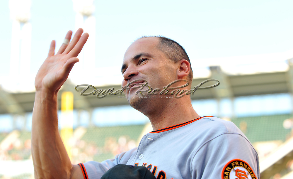 Omar Vizquel waves to the fans of Cleveland after watching a tribute video before his first game back in Cleveland.