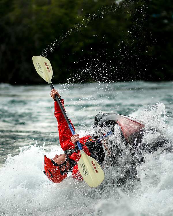 Kayakers and canoeists compete in the Whitewater Rodeo.