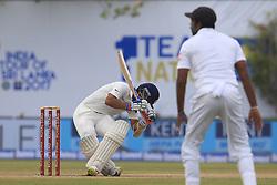 July 27, 2017 - Galle, Sri Lanka - Indian cricketer Ajinkya Rahane(L) loses his balance  after facing a ball from Sri Lanka's Nuwan Pradeep(unseen) during  the 2nd Day's play in the 1st Test match between Sri Lanka and India at the Galle International cricket stadium, Galle, Sri Lanka on Thursday 27 July 2017. (Credit Image: © Tharaka Basnayaka/NurPhoto via ZUMA Press)