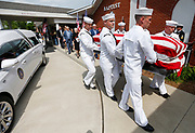 Members of the United States Navy Honor Guard carry the casket of Clifford George Goodwin into the First Baptist Church of Diamond on Saturday, May 12, 2018. Goodwin was killed at Pearl Harbor during World War II while serving aboard the USS Oklahoma with the U.S. Navy. His remains were recently identified using DNA analysis and he was returned to Missouri from Hawaii to be buried with full military honors.