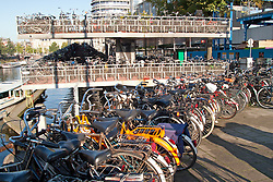 Bicycles by the thousands await their owners outside Amsterdam's central train station.