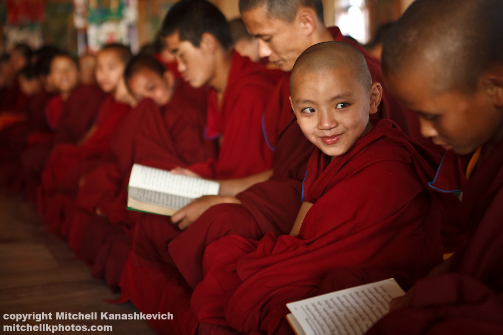 Monks in a class room in a monastery at Bylakuppe Tibetan refugee camp, Karnataka, India