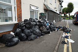 © Licensed to London News Pictures. 12/08/2016. Birmingham, UK. The strike by Birmingham bin men continues as they announce strike action up to Christmas. Pictured, rubbish building up in Brighton Road, Balsall Heath. Photo credit: Dave Warren/LNP