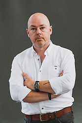 "Edinburgh, Scotland, UK. 25 August, 2018. Pictured; Author John Boyne has built on the staggering success of ""The Boy in the Striped Pyjamas"" with a series of acclaimed novels for adults. He launches ""A Ladder to the Sky"", a fascinating portrayal of Maurice Swift, a would-be writer who finds that literary success can come by stealing stories."