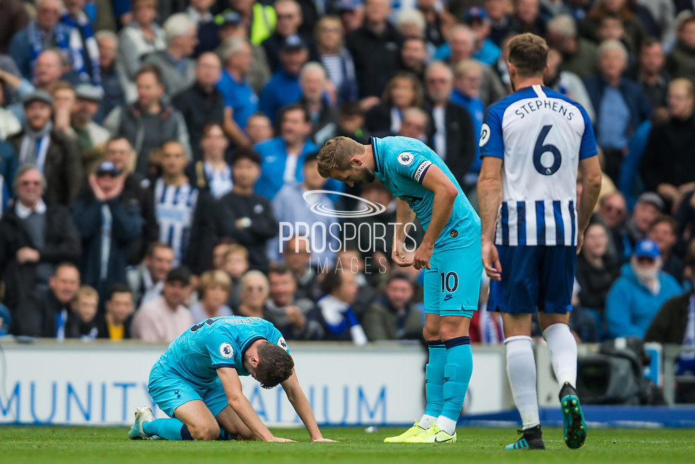 Ben Davies (Tottenham) injured and being assessed by Harry Kane (Tottenham) during the Premier League match between Brighton and Hove Albion and Tottenham Hotspur at the American Express Community Stadium, Brighton and Hove, England on 5 October 2019.