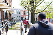 Baltimore, Maryland - April 21, 2015: A man runs from police through the same walkway Freddie Gray was arrested in two Sundays ago. Gray, 25 died from injuries sustained while in police custody. His spine was reportedly 80% severed.<br /> <br /> CREDIT: Matt Roth for The New York Times<br /> Assignment ID: 30173645A