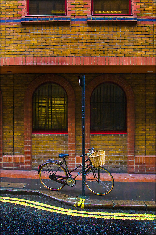 A push bike parked outside a large building