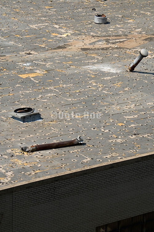 rooftop of industrial building with exhaust pipes in a dilapidated state