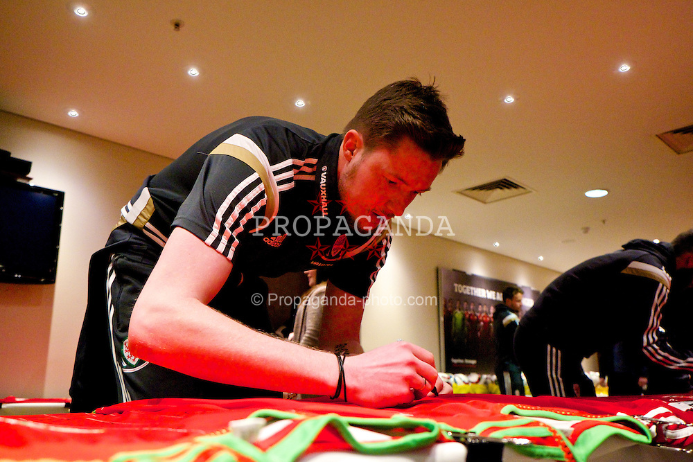 CARDIFF, WALES - Wednesday, March 25, 2015: Wales' goalkeeper Wayne Hennessey signs autographs at the Vale of Glamorgan ahead of the UEFA Euro 2016 qualifying Group B match against Israel. (Pic by David Rawcliffe/Propaganda)