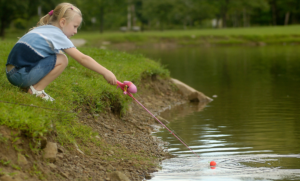 Aug. 21, 2005 Jason Miller Darla Allen, 5, from North Ridgeville keeps her bobber in close to the shore on Sunday, Aug. 21, 2005 during her weekly fishing expedition with her father Chris at South Central Park in North Ridgeville.