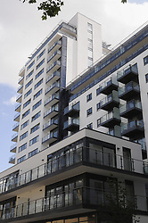 © Licensed to London News Pictures. 11/06/2014.  Knights Tower. Two teenagers have died after falling from a sixth-floor balcony during a party in Deptford. Police were called this morning (June 11) at 12.13am to Knights Tower in Wharf Street to reports of two people having fallen from a balcony. An 18-year-old man and a 19-year-old woman were pronounced dead at the scene. Local people have identified the flat as having a Turkish flag in the window next to the balcony. Byline:Grant Falvey/LNP