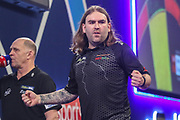 Ryan Searle wins his first round match against Robbie King and celebrates during the PDC William Hill World Darts Championship at Alexandra Palace, London, United Kingdom on 17 December 2019.