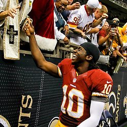 September 9, 2012; New Orleans, LA, USA; Washington Redskins quarterback Robert Griffin III (10) celebrates with fans after a win over the New Orleans Saints at the Mercedes-Benz Superdome. The Redskins defeated the Saints 40-32. Mandatory Credit: Derick E. Hingle-US PRESSWIRE