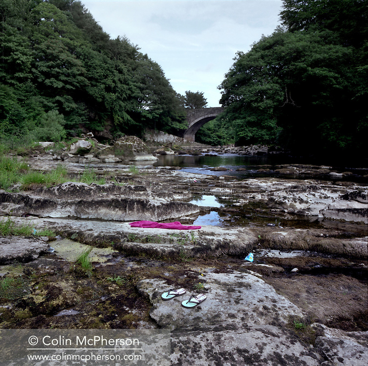 'Penton Bridge, 2013' from 'A Fine Line - Exploring Scotland's Border with England' by Colin McPherson.<br /> <br /> This historic bridge over the Liddel Water marks the border and is a popular place for people from both countries to relax and socialise.<br /> <br /> The project was a one-year exploration of the border between the two historic nations, as seen from the Scottish side of the frontier.<br /> <br /> Colin McPherson is a photographer and visual artist based in north west England. In 2012 he was one of the founding members of Document Scotland, a collective of four Scottish documentary photographers brought together by a common vision to witness and photograph the important and diverse stories within Scotland at one of the most important times in our nation's history.<br /> <br /> 'A Fine Line' will be shown for the first time in public at Impressions Gallery, Bradford, from July 1 until September 27, 2014 to coincide with the Scottish Independence referendum.