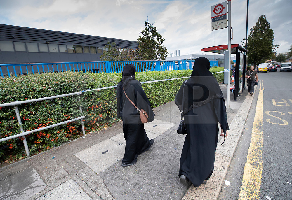 © Licensed to London News Pictures. 19/09/2018. London, UK. Worshippers pass a bus stop surrounded by police cordon tape opposite the entrance to The Hussaini Association Islamic Centre in Cricklewood, north London where a car hit two pedestrians last night. The incident , which took place in the early hours of this morning outside the centre, is being treated as a possible hate crime. Police are looking for a male driver who failed to stop at the scene, as well as two men and one woman in the car, all in their 20s. Photo credit: Peter Macdiarmid/LNP