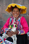 "They call them ""llamitas"" because often bring with them a lama, but you can more easily see with a lamb in her arms. Dressed in their traditional clothes, that in their villages of origin are the dress of everydays, this ladies have realized that you can earn from the pictures. As the local models are proposed to pose with or without tourists, the price is ""su voluntad"" ( just a tip) but always a little angry' when the will is only a couple of nuevo soles (60 cents)"