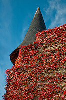 Our Lady of Chartres Cathedral, Chartres, France. Outbuilding - red ivy growing on a tower with the backdrop of a brilliant blue sky.