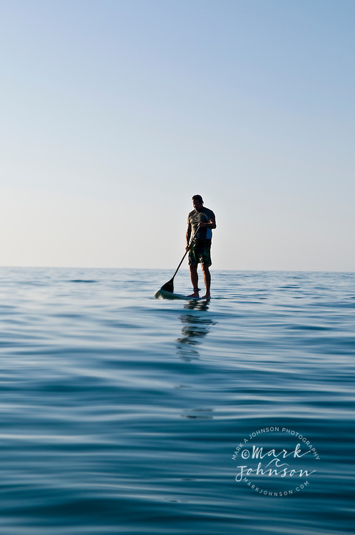 Stand Up Paddle Surfer on calm sea, Baja California Sur, Mexico