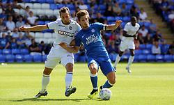 Alex Woodyard of Peterborough United in action with Adam Le Fondre of Bolton Wanderers - Mandatory by-line: Joe Dent/JMP - 28/07/2018 - FOOTBALL - ABAX Stadium - Peterborough, England - Peterborough United v Bolton Wanderers - Pre-season friendly