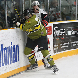 TRENTON, ON  - MAY 4,  2017: Canadian Junior Hockey League, Central Canadian Jr. &quot;A&quot; Championship. The Dudley Hewitt Cup. Game 5 between Powassan Voodoos and the Georgetown Raiders.  Cade Herd #74 of the Powassan Voodoos makes the hit on Arran MacDonald #7 of the Georgetown Raiders during the first period.<br /> (Photo by Tim Bates / OJHL Images)