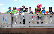 Juan-Carlos Capelli, center left, and Jennifer Judkins, center right, greet jockeys from the $300,000 Churchill Distaff Turf Mile presented by Longines on Kentucky Derby day, Saturday, May 3, 2014, in Louisville, Ky., Longines, the Swiss watchmaker known for its famous timepieces, is the Official Watch and Timekeeper of the 140th annual Kentucky Derby. (Photo by Diane Bondareff/Invision for Longines/AP Images)