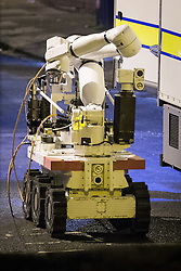 © Licensed to London News Pictures . FILE PICTURE DATED 28/11/2013 of an army bomb disposal robot outside the home of Rifleman Ryan McGee on Mellor Street in Eccles , Greater Manchester as today (28th November 2014) McGee has been jailed for making a nail bomb containing 181 screws and pieces of broken glass in his bedroom . Photo credit : Joel Goodman/LNP