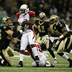 2007 December, 16: New Orleans Saints defenders Scott Fujita (55) and Jason Craft (21) combine on a tackle of Cardinals receiver Anquan Boldin (81)during a 31-24 win by the New Orleans Saints over the Arizona Cardinals at the Louisiana Superdome in New Orleans, LA.