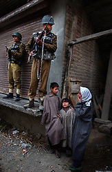 SRINAGAR, INDIA, MARCH 10, 2004:Children cry as Indian army bring back the bodies of  five people who were killed when a grenade exploded in the hands of a man who was seeking to extort money from a family in Budgam district of Kashmir, March 10, 2004.   Locals said the man was a former militant who was extorting money from villagers and thousands came out to mourn the deaths. Tens of thousands of people have died in Kashmir since the eruption of anti-Indian revolt in the region in 1989. Separatists put the toll at between 80,000 and 100,000.