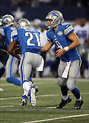 Detroit Lions quarterback Matthew Stafford (9) hands off the ball on a running play to Detroit Lions running back Reggie Bush (21) during the NFL week 18 NFC Wild Card postseason football game against the Dallas Cowboys on Sunday, Jan. 4, 2015 in Arlington, Texas. The Cowboys won the game 24-20. ©Paul Anthony Spinelli