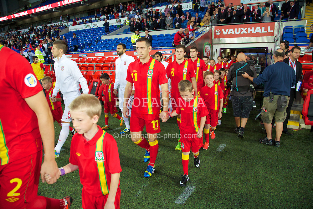 CARDIFF, WALES - Tuesday, September 10, 2013: Wales' Andrew Crofts walks out to face Serbia during the 2014 FIFA World Cup Brazil Qualifying Group A match at the Cardiff CIty Stadium. (Pic by David Rawcliffe/Propaganda)