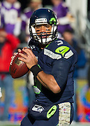 Seattle Seahawks quarterback, Russell Wilson looks for a target during a game against the Minnesota Vikings. The Seahawks beat the Vikings 41-20. Photo by John Lill.