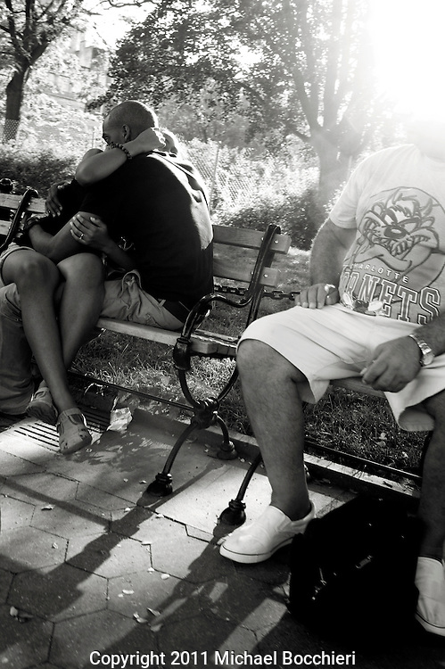 NEW YORK, NY - August 10:  A couple embrace on a bench in Washington Square Park on August 10, 2011 in NEW YORK, NY.  (Photo by Michael Bocchieri/Bocchieri Archive)