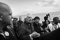 ACI TREZZA, ITALY - 28 OCTOBER 2017: Beppe Grillo (center), leader of the Five Star Movement (Italian: Movimento 5 Stelle, or M5S), who supports the candidacy of Giancarlo Cancelleri,  running for governor of Sicily in the upcoming Sicilan regional election, is seen here surrounded by supporters and the press during a rally in Aci Trezza, Italy, on October 28th 2017. <br /> <br /> The M5S organised a march from Aci Trezza to Catania (6 miles), where a rally will be held in the evening.<br /> <br />  The Sicilian regional election for the renewal of the Sicilian Regional Assembly and the election of the President of Sicily will be held on 5th November 2017.