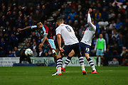 Burnley striker Andre Gray strikes during the Sky Bet Championship match between Preston North End and Burnley at Deepdale, Preston, England on 22 April 2016. Photo by Pete Burns.