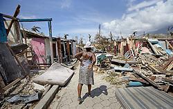 October 9, 2016 - HTI - An elderly woman walks along a debris filled street in Roche a Bateau, Haiti on Sunday, Oct. 9, 2016. (Credit Image: © Patrick Farrell/TNS via ZUMA Wire)