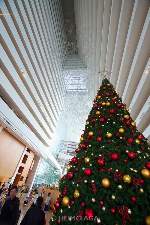Singapore. Marina Bay Sands Hotel. the atrium lobby. Christmas tree.