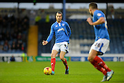 Portsmouth defender Christian Burgess pass to Portsmouth striker Gareth Evans during the Sky Bet League 2 match between Portsmouth and Hartlepool United at Fratton Park, Portsmouth, England on 12 December 2015. Photo by Adam Rivers.