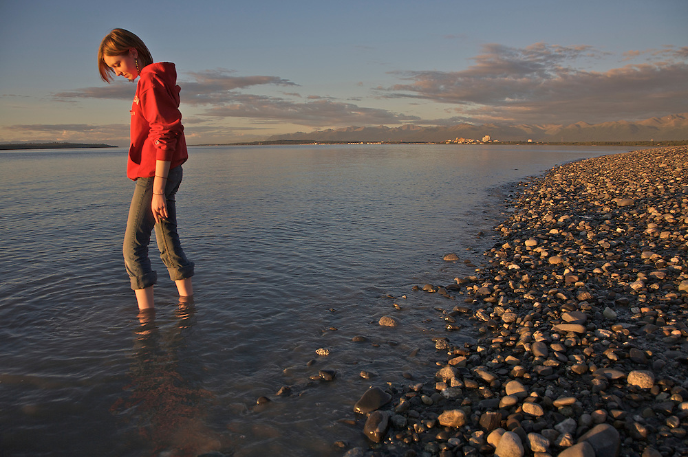 Girl on beach near Point Woronzof, Anchorage, Alaska