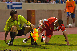 Nicosia, Cyprus - Saturday, October 13, 2007: Wales' captain Craig Bellamy crashes into the assistant referee during the Group D UEFA Euro 2008 Qualifying match against Cyprus at the New GSP Stadium in Nicosia. (Photo by David Rawcliffe/Propaganda)