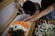 SHANGHAI, CHINA - AUGUST 29: (CHINA OUT) <br /> <br /> A worker tidies up a deceased dog during it\'s funeral bought online with 8,000 RMB on August 29, 2015 in Shanghai, China. Miss Wang spent more than 8,000 RMB (about 1,252.8 USD) to buy her deceased dog a funeral on Taobao.com which is China\'s biggest online shop. The dog\'s funeral includes memorial service, cremation and religious rite. The host of the online funeral shop said that they received orders of animal funerals almost everyday. <br /> ©Exclusivepix Media