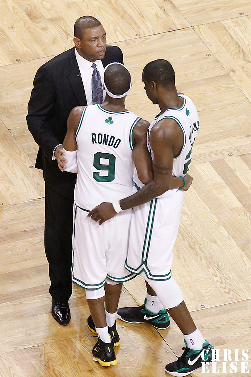 07 June 2012: Boston Celtics head coach Doc Rivers talks to Boston Celtics small forward Mickael Pietrus (28) and Boston Celtics point guard Rajon Rondo (9) during the Miami Heat 98-79 victory over the Boston Celtics, in Game 6 of the Eastern Conference Finals playoff series, at the TD Banknorth Garden, Boston, Massachusetts, USA.