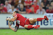 Quade Cooper juggles the ball in back play during action from the Super 15 Rugby Union match played between the Queensland Reds and the NSW Waratahs at Suncorp Stadium (Brisbane, Australia) on Saturday 23rd April 2011<br /> <br /> Conditions of Use : NO AGENTS ~ This image is intended for Editorial use only (news or commentary, print or electronic) - Required Images Credit &quot;Steven Hight - Aura Images&quot;