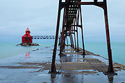 Lighthouse on Lake Michigan in Sturgeon Bay, Wisconsin at dawn on a winter morning.