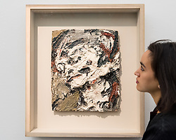 "© Licensed to London News Pictures. 01/11/2016. London, UK. A staff member views ""Head of Gerda Boehm"" by Frank Auerbach, a much loved favourite of David Bowie's, est. GBP300-500k. The first look of ""Bowie / Collector"", artworks from the late David Bowie's personal art collection, ahead of their sale later this month at Sotheby's. Photo credit : Stephen Chung/LNP"