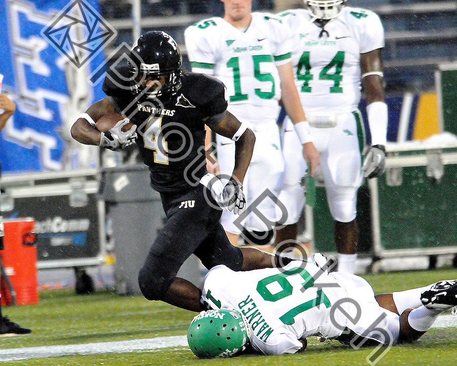 2011 September 01 - Florida International wide receiver T.Y. Hilton (4) evading tackle from North Texas defensive back Freddie Warner (19). Florida International University Golden Panthers defeated the University of North Texas Mean Green (41-16) in the Alfonso Field at FIU Stadium, Miami, Florida. (Photo by: www.photobokeh.com / Alex J. Hernandez)